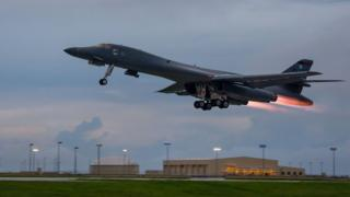 In this US Air Force image obtained from the US Defense Department, a US Air Force B-1B Lancers takes off from Andersen Air Force Base, Guam, 10 October 2017