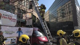 South Wales Fire and Rescue Service firefighters take part in the ladder climb