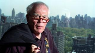 Author-columnist Jimmy Breslin poses for a photo in his New York apartment. Breslin, the Pulitzer Prize-winning chronicler of wise guys and underdogs who became the brash embodiment of the old-time, street smart New Yorker, died Sunday, March 19, 2017.