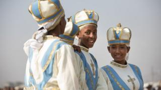 Young clergy girls react during the Timket, or Epiphany festival, in Addis Ababa, on January 19, 2018.