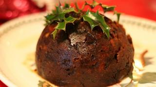 A traditional Christmas Pudding with holly decoration