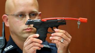 The gun used to kill Trayvon Martin is displayed during Mr Zimmerman's court trial