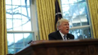 Donald Trump at his desk