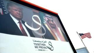 Poster showing US President Donald Trump and Saudi Arabia's King Salman, is seen on a main road in Riyadh, on May 19, 2017
