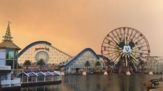 Disney theme park and orange sky