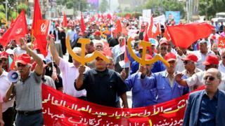 Members of the Iraqi Communist party shout slogans and carry communist flags and the communist symbols during a demonstration to mark Labour Day, in central Baghdad, Iraq, 01 May 2018.