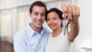 couple with house keys