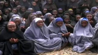 A screengrab taken on May 12, 2014, from a video of Nigerian Islamist extremist group Boko Haram obtained by AFP shows girls, wearing the full-length hijab and praying in an undisclosed rural location.