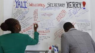 Kenyans write welcome messages for US Secretary of State John Kerry at a hotel where Kerry is having a ministerial meeting with his African counterparts in Nairobi, Kenya, 22 August 2016