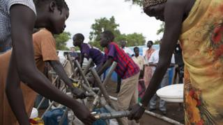 South Sudanese refugees collect water at the Kule camp for internally displaced people at the Pagak border crossing in Gambella, Ethiopia, 10 July 2014