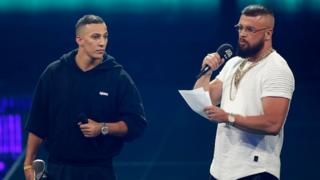 "German rappers Kollegah and Farid Bang receiving the ""Hip-Hop/Urban national"" award during the 2018 Echo Music Awards on 12 April"