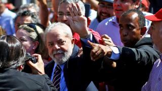 Former Brazilian President Luiz Inacio Lula da Silva arrives at the Federal Justice office to be questioned by anti-corruption judge Sergio Moro, in Curitiba