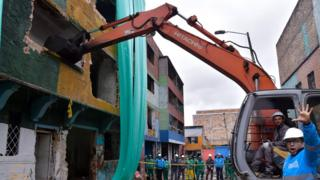 A demolition crew in Bogota's Bronx slum, 10 August