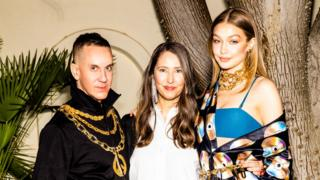 Moschino's creative director Jeremy Scott with Ann-Sofie Johansson, creative advisor of H&M and Gigi Hadid