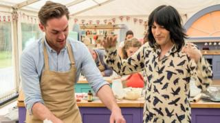Noel Fielding with baker Tom in The Great British Bake Off
