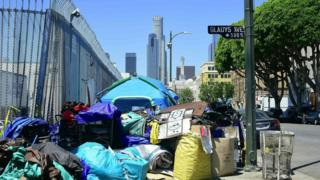 Tents housing the homeless and their belongings crowd a street corner in Los Angeles, California on April 20, 2017