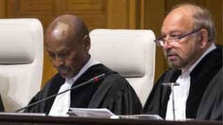 Ronny Abraham (right) sits in the court at the Hague on September 24, 2015
