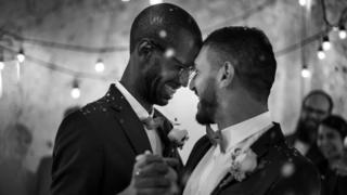 Gay men dancing at wedding