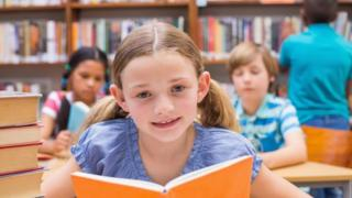 Child in school library