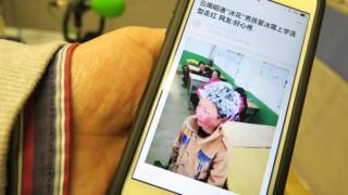人民日報客戶端上刊登的「冰花男孩」王福滿照片(BBC中文網圖片12/1/2018)