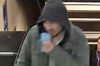 Person of interest in Stockholm attack: a young, hooded man