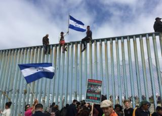 Protesters gather at the US-Mexico border fence at a beach in Tijuana, Mexico, 29 April 2018