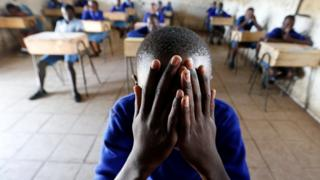 A pupil prays inside a classroom ahead of the primary school final national examinations at Kiboro Primary school along Juja road in Nairobi, Kenya - 31 October 2017