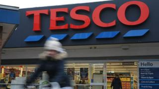 Blurred figure in front of Tesco