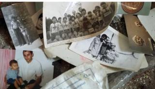Among the debris there are many family photographs
