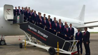 The Welsh team boards the plane