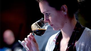 Brazilian beer sommelier Fernanda Meybom samples a beer at the Copa Cervezas de América