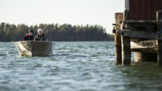Two people boating on one of Finland's 187,888 lakes