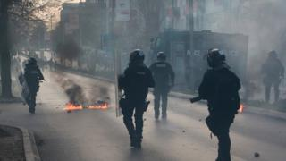 Police patrol the streets during during a protest in the centre of Kosovo's capital Pristina on 18 November 2015.