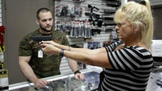 Customer in a gun shop in Pompano Beach, Florida. 5 Jan 2016