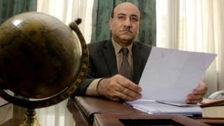 Hisham Geneina (file photo, 16 April 2014)