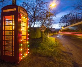 Redundant phone box at Redpath in the Scottish Borders gets a festive make-over