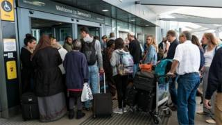 People queuing at Heathrow after BA IT chaos