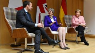 May urges 'new dynamic' in Brexit talks