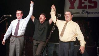 David Trimble, Bono and John Hume pictured together on stage at the Waterfront hall in Belfast