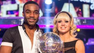 Ore Oduba holds Newsround trophy after winning the competition last year.