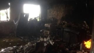One of the first images from inside the tower shows a small fire still burning inside one flat