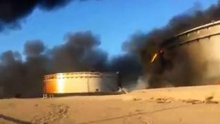 Image grab of oil storage tanks on fire in Sidra. 5 Jan 2016