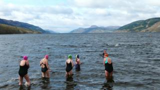 Swimmers in Loch Ness