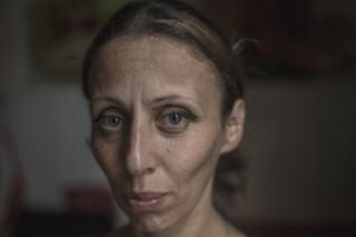 Ia Ochiauri, 42, a mother of two lives with her husband and his brother . They do odd jobs when they can