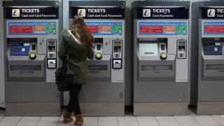 Woman buying rail ticket
