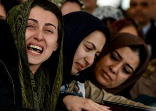 Women mourn over the coffin of one of the victim's of Sunday's bombing in Ankara