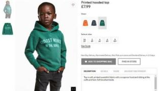Photo of H&M latest advert show black pickin dey model sweat shirt hoodie wey dem write 'coolest monkey in the jungle' on top