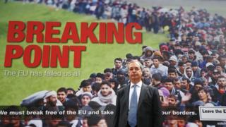 Nigel Farage with UKIP poster