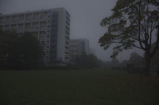 A misty view of nearby tower blocks