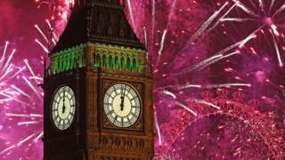 Fireworks explode around Big Ben in London to mark New Yearcelebrations